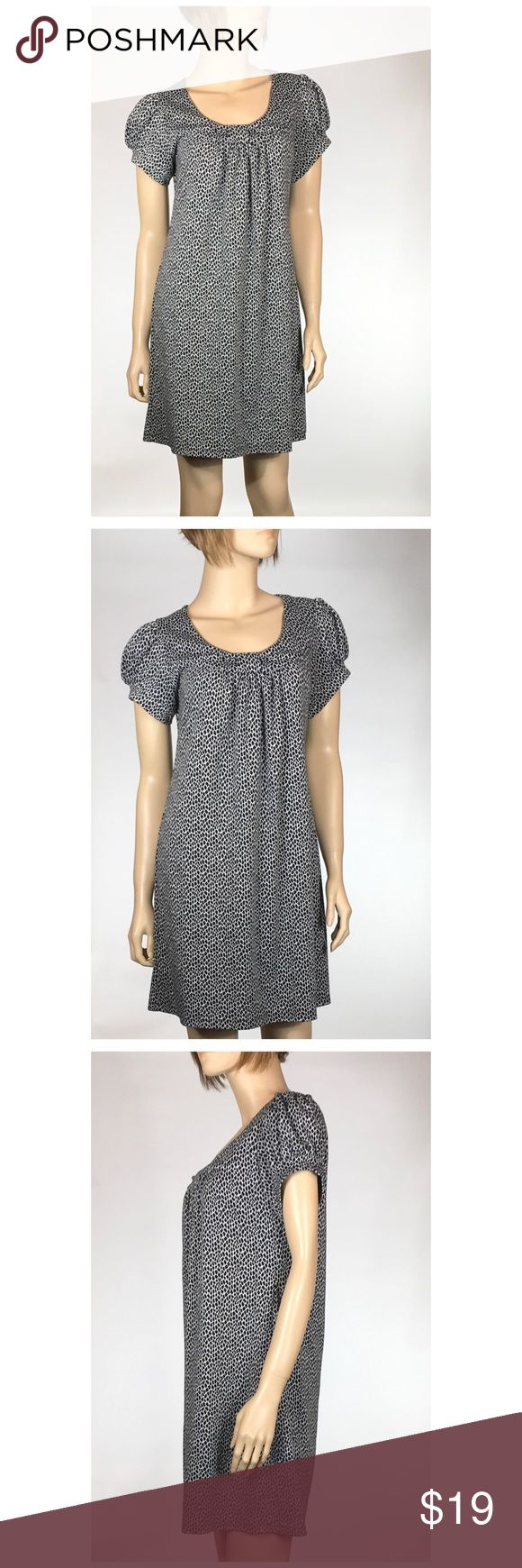 Enfocus Studio Animal Print Dress or Tunic Black and gray short-sleeved dress is a size 12. 33 inches long. Chest measures 18.5 inches across from armpit to armpit. 82% polyester 16% rayon 2% spandex. It has quite a bit of stretch to it and is in excellent condition. Enfocus Studio Dresses