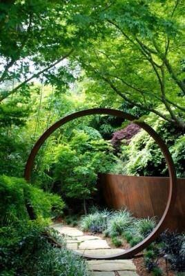 I like the circle as a focal sculpture element to the garden. Recycle an old bit of metal from a farm?