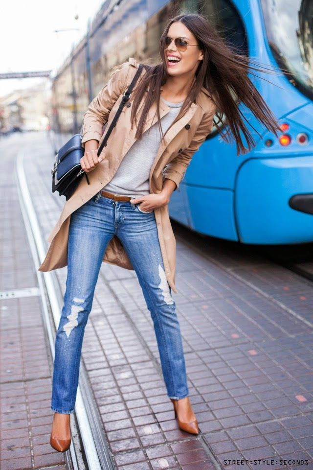 Stand out among other stylish civilians in a tan trenchcoat and blue destroyed slim jeans. Complement this look with khaki leather pumps. Shop this look on Lookastic: https://lookastic.com/women/looks/trenchcoat-crew-neck-t-shirt-skinny-jeans-pumps-crossbody-bag-belt-sunglasses/8882 — Brown Sunglasses — Grey Crew-neck T-shirt — Tan Trenchcoat — Black Leather Crossbody Bag — Brown Leather Belt — Blue Ripped Skinny Jeans — Tan Leather Pumps