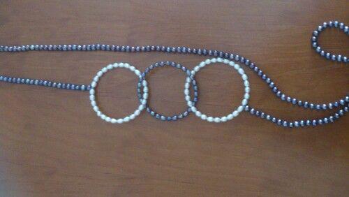 Aros dr perlas en gris y blanco