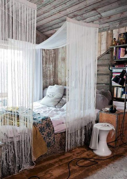 draped canopy beds - boho draped canopy bed in a rustic Scandinavian cabin - Trine Thorsen/Skonahem via Atticmag