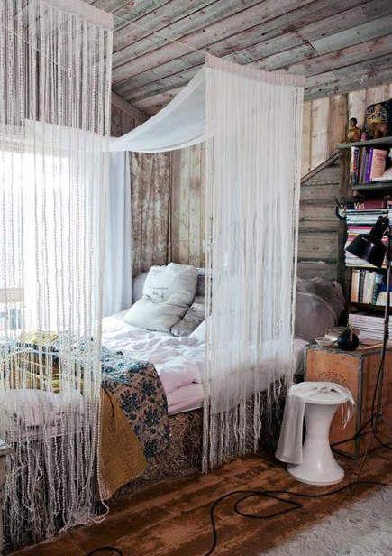 draped canopy beds - boho draped canopy bed in a rustic Scandinavian cabin - Trine Thorsen/Skonahem via Atticmag