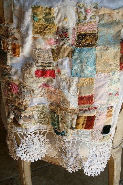 quilt with lace trim.