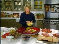 Martha Stewart assembles a quick and easy antipasto platter with roasted peppers, provolone cheese, and prosciutto ham.