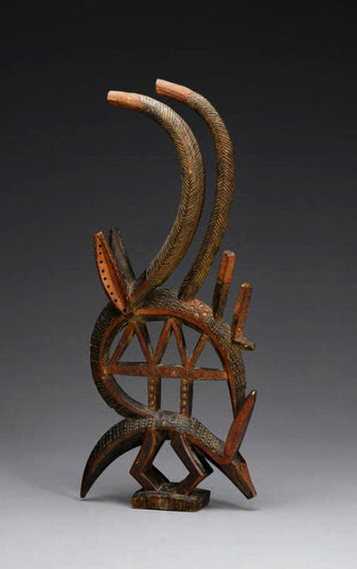 Africa | Antelope head crest ~ chiwara ~ from the Bamana people of Mali | Wood, pigments | Prior to 1960s