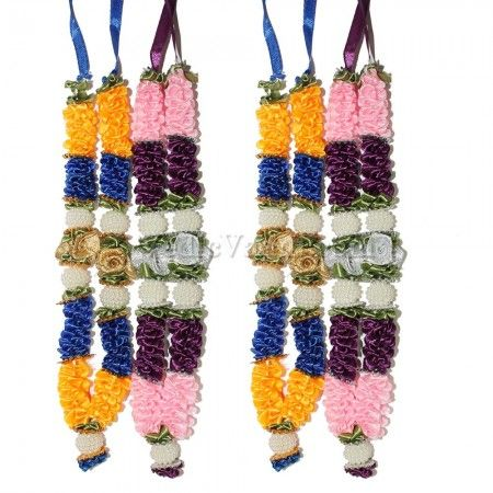 Deity Garland online store, Artificial Puja Haar Vedicvaani.com Har of Lord Krishna garland online shopping Flower Haar, garlands made of Satin flowers. Exotic Blue Violet Garland, Artificial garland made of Satin flowers in White and Maroon Ribbon and golden tissue flowers with white color motifs. A smile on your face just through their presence. These garlands are ideal for offering on deity idols, altar, entrance doors. It is a sign of welcoming and invoking the blessings of a deity.