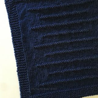 The State Line Blanket is knit with super bulky weight yarn so it is quick to knit on big needles.