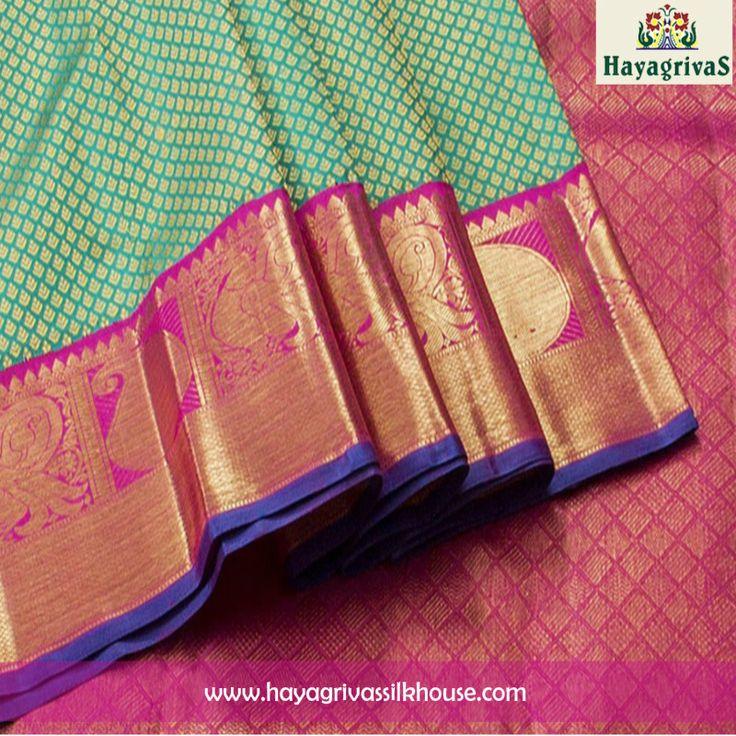 Trendy Green #Kanjivaram #silksaree along with zari putta on the body and pink color border and pallu with zari mango motifs. Huge collection of handwoven #silksaree collection available in different colors, patterns and designs. #Silksarees #Kanjivaramsarees #Weddingsilks #Traditionalsarees Visit us: https://www.hayagrivassilkhouse.com/saris/2456.html Call us: 91 9840582892