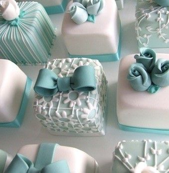 Amazingly detailed small cakes in aqua and white