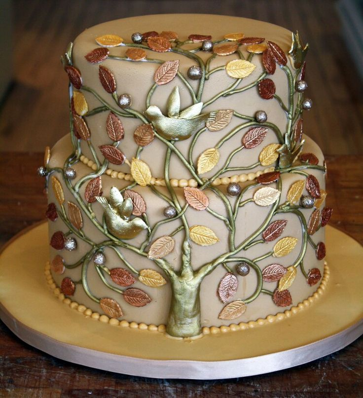 taupe cake, copper trunk, gold and silver leaves