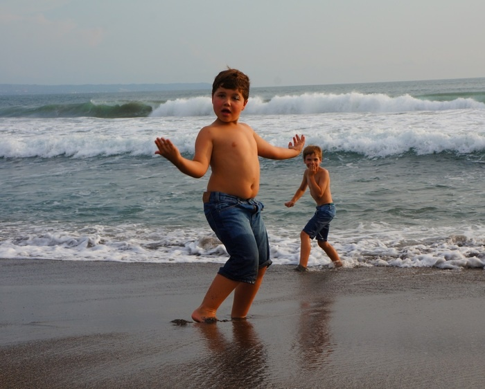 Free expression. A kid poses to the camera, while he and his family have some quality time at Canggu beach. Photo by Rad...
