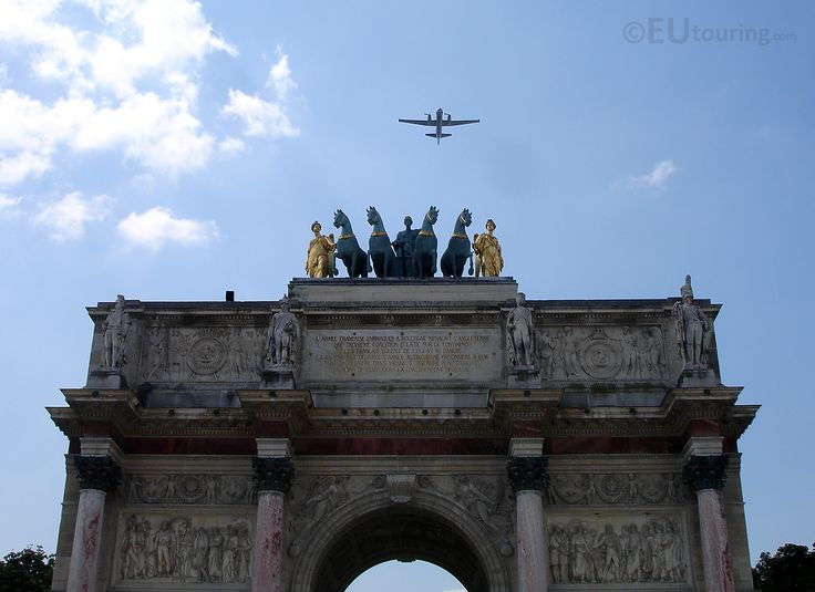 A rare capture of a fly-by, with a plane heading directly over the Arc de Triomphe du Carrousel.  Daily updates at www.eutouring.com/images_arc_de_triomphe_du_carrousel.html