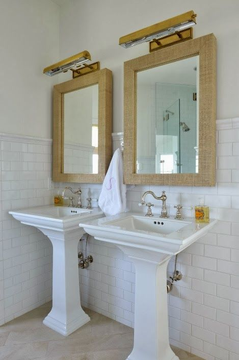 Seagrass mirrors, double pedestal sinks | Munger Interiors
