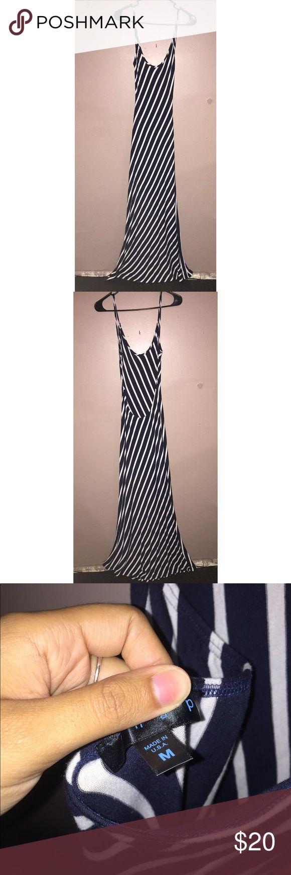 Striped formal dress Beautiful striped dress and backless. Body fitting and flares at the end Dresses Backless