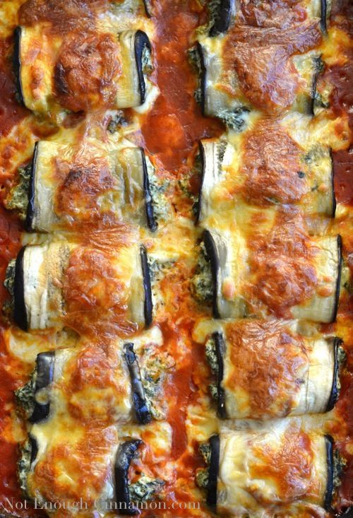 Skinny Eggplant Rollatini | notenoughcinnamon.com2 large eggplants 1 cup (9 oz/ 250 g jar) reduced fat ricotta 1 1/2 cups shredded light mozzarella, divided in 1/2 cup and 1 cup 1/2 cup shredded parmesan 9 oz / 250 g frozen spinach, thawed and squeezed to remove as much liquid as possible 1 egg 1 garlic clove, germ removed, minced salt and pepper to taste 1 cup tomato passata or marinara