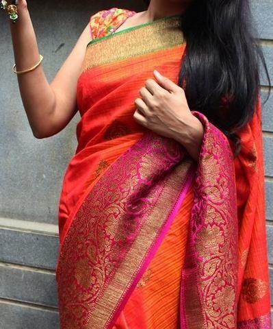 Bright orange banaras dupion silk saree with contrast border