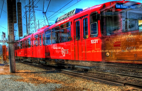 Moving at the speed of light. The San Diego Trolley is a significant means of transportation in and around San Diego. Photo by Paul W. Koester.