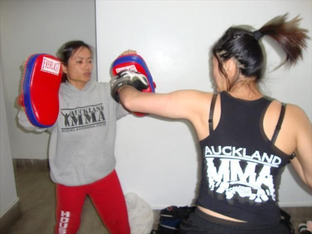 Tee being warmed up by coach Van before her fight