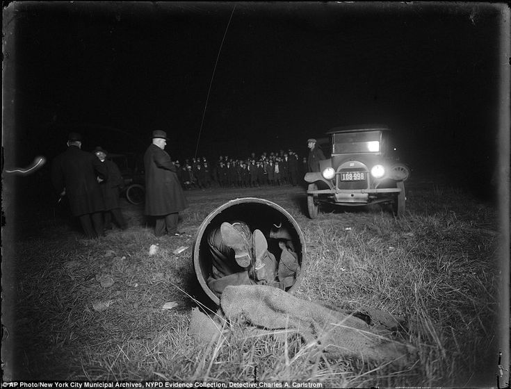 A crime scene photo in 1918 -- the body of Gaspare Candella found stuffed in a drum and dumped in a field in Brooklyn, New York