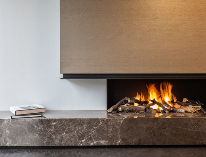 Contemporary linear fire slot with Emperador marble hearth / plinth detail