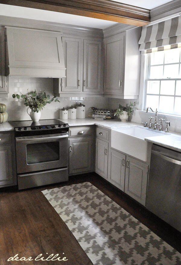 Gray Kitchen with White Glass Subway tile for the backsplash Best 25  Grey kitchen floor ideas on Pinterest
