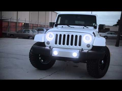 ORACLE Jeep Wrangler LED Halos with ORACLE Off-Road Mirrors, ORACLE Off-Road Spotlights, Red Tail Light Halos and front White Headlights and Fogs.