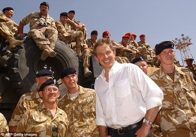 Hideously unjustified: Tony Blair, pictured in Iraq in 2003, set out on an outrageously de...
