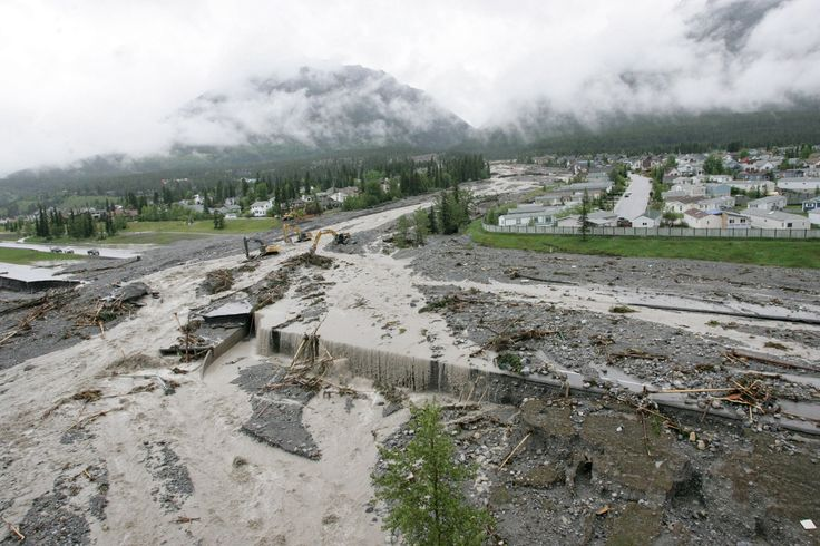 Cougar Creek beats Hwy 1 in Canmore - Alberta Floods