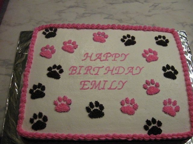 paw prints - half white half chocolate cake with buttercream frosting and paw prints