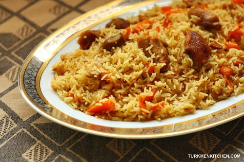 Palaw – Turkmen Pilaf Serves 8 1 kg chicken/turkey/lamb/beef 2 tablespoons salt 300 ml (1⅕ cups) vegetable oil 1 large onion, halved and sliced 5 large carrots, julienned 1 l + 375 ml (5½ cups) wat…