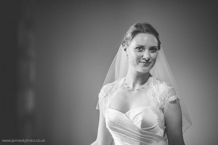 Stradsett Church, Norfolk Wedding. Beautiful bride. Black and white. Lace bolero wedding dress. www.jameskphoto.co.uk