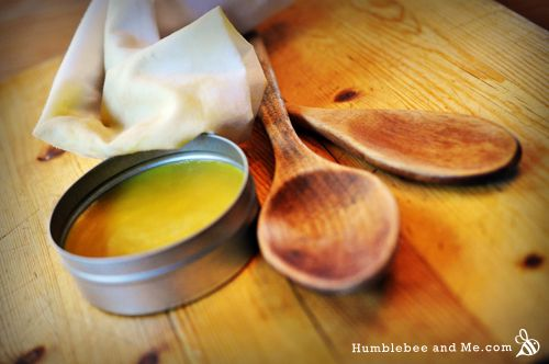 orange wax wood polish  15g beeswax 15g orange wax 35g olive oil  Melt everything together in a small saucepan over medium low heat. Let set up.  To use, buff onto wooden kitchen implements, let soak in, and buff off any excess.  If you don't have orange wax, you can use 50g of olive oil and 10 drops orange essential oil.