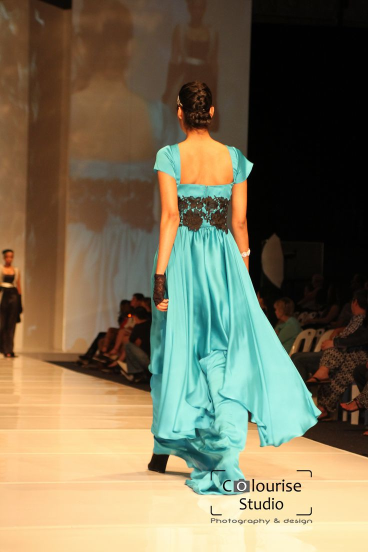Blue italian satin gown with a guipure lace waistband.