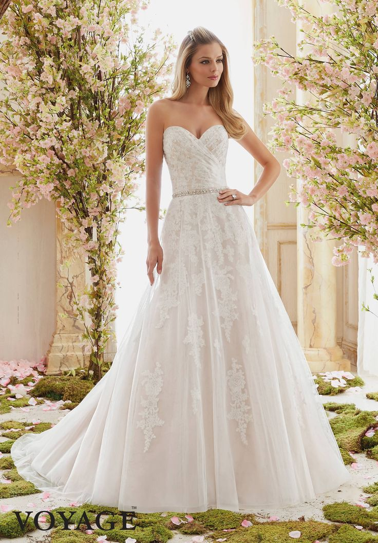 Morilee Voyage collection. Style number 6834. Elegant sweetheart strapless lace bodice. A-line wedding dress. Lace detail on tulle train.