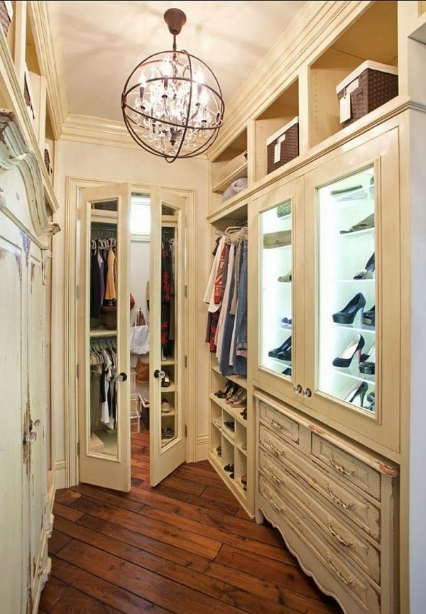 Love how the dresser tucks under the built-in cabinet in this closet.