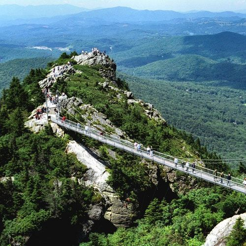 Grandfather Mountain | Linville, NC If you're brave enough to cross this mile-high swinging bridge, you'll get a killer view... Be careful, this is one of the windiest spots in America.