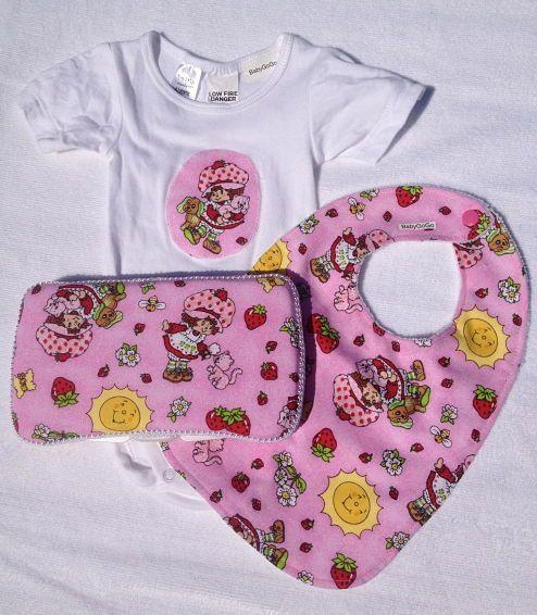 Strawberry Shortcake gift set-3 items-Strawberry shortcake gift set.  Includes baby wipe case, bib and matching shortsleeve onesie.  Makes a great baby shower gift.