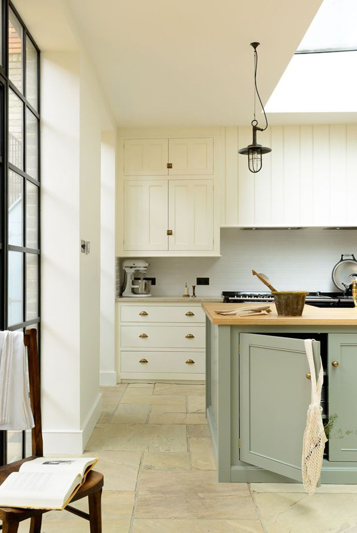 antique brass hardware, white cabinets and black accents! 2018 Forecast: Kitchen Design