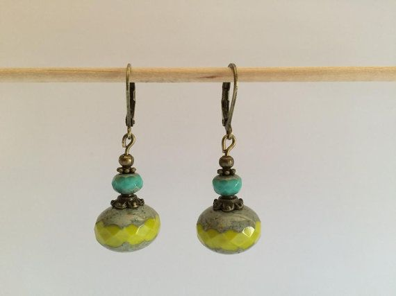 Bronze earrings with a clear green czech and turquoise glass bead.  The size is 1.57 inches (4 cm) and the bead is 0.35 x 0.55 (9x14 mm).