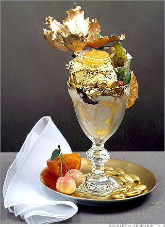 Golden Opulence sundae. $1,000. 5 scoops of Tahitian vanilla ice cream w/Madagascar vanilla & covered in 23K edible gold leaf. Drizzled w/Amedei Porceleana chocolate. Covered w/chunks of Chuao chocolate. Exotic candied fruits, gold dragets, truffles & Marzipan Cherries. Glass bowl of Grand Passion Caviar w/fresh passion fruit, orange & Armagnac. Served in a baccarat Harcourt crystal goblet w/an 18K gold spoon also w/a petite mother of pearl spoon & topped w/a sugar flower.