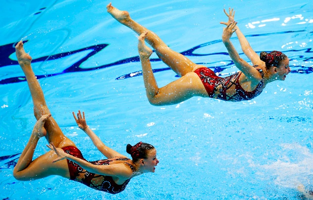 Competitors from Russia perform during the team's technical routine at the synchronised swimming Olympic test event at the Aquatic Centre in the Olympic Park, London, Thursday, April 19, 2012. Source: AP
