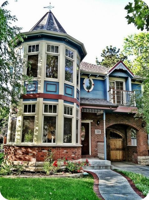 victorian style home. note: tower, bay window, 2 story, multi colored, porches, gingerbread