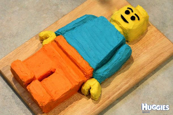 This is a near exact scale up of a Lego minifigure. This was simply done by measuring the dimensions and scaling up 10 times, so he is ~40cm long. I made my own rainbow cake for this, carved it out and iced with a butter frosting. The trickiest parts were making the hands and getting the yellow colour correct. My son loved that I (his Dad) made this for him!
