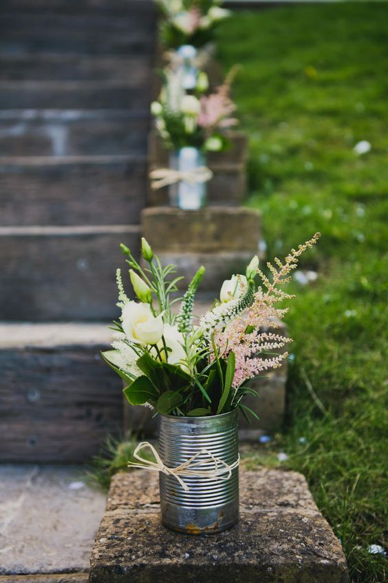 white and pink flowers tin can wedding decor / http://www.himisspuff.com/astilbes-wedding-ideas/10/