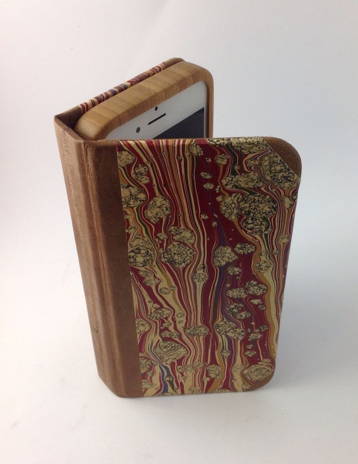 iPhone case for iPhone 6s. Eel skin, hand marbled paper, and map.