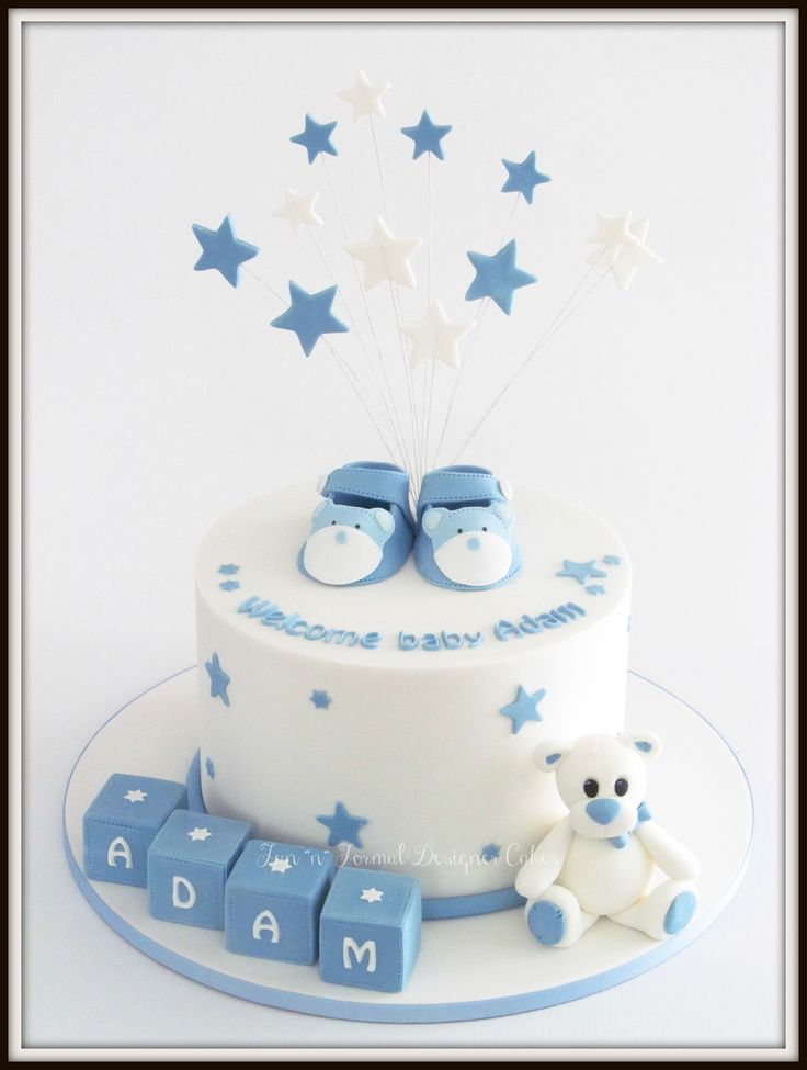 Welcome baby cake with blocks, bear and booties.