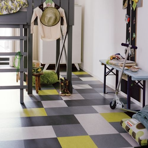 Forbo Marmoleum Click. For kitchen floor. Goes right over the vinyl without adding too much height.