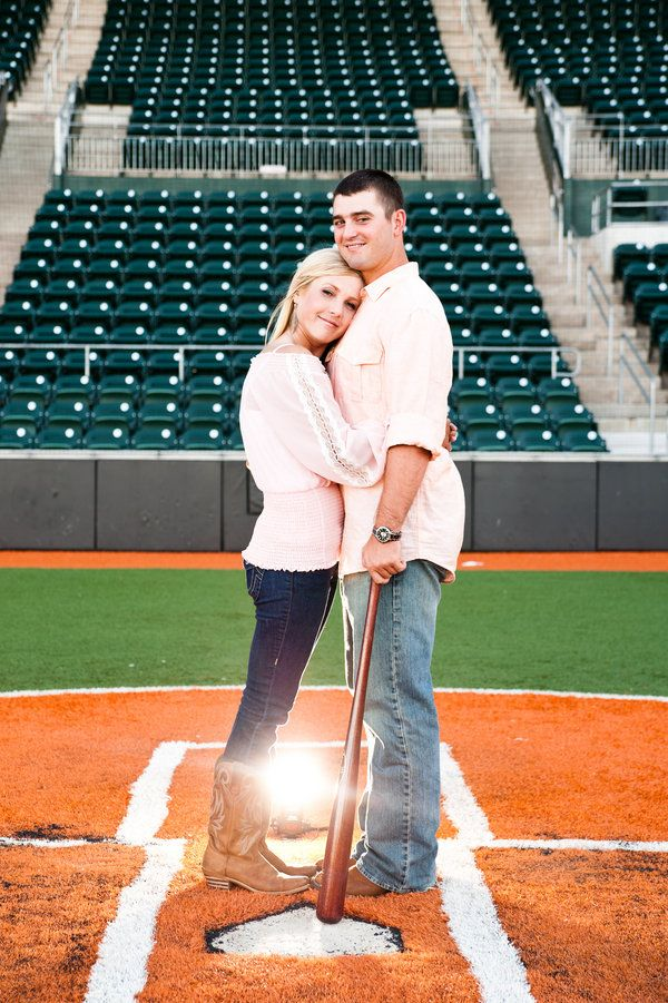 The season has begun, and baseball fans will be tuning in or sitting in the stands for MLB's return. Not only are the Spring months full of baseball excitement, but they're also prime for throwing a wedding. If you and your partner are fans of the all-American sport, there are a plethora of fun ways to incorporate baseball intp your engagement shoot, bridal parties, and wedding day. From the location to the decor to the food, here are some creative ideas for adding a little game day spirit…
