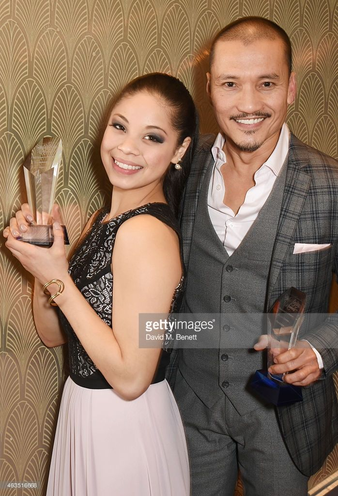 Best Actress in a Musical winner Eva Noblezada (L) and Best Actor in a Musical winner Jon Jon Briones from 'Miss Saigon' pose in the press room at the WhatsOnStage Awards at The Prince of Wales Theatre on February 15, 2015 in London, England.