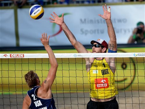 Casey Patterson of USA spikes the ball as Alison Conte Cerutti of Brazil defends